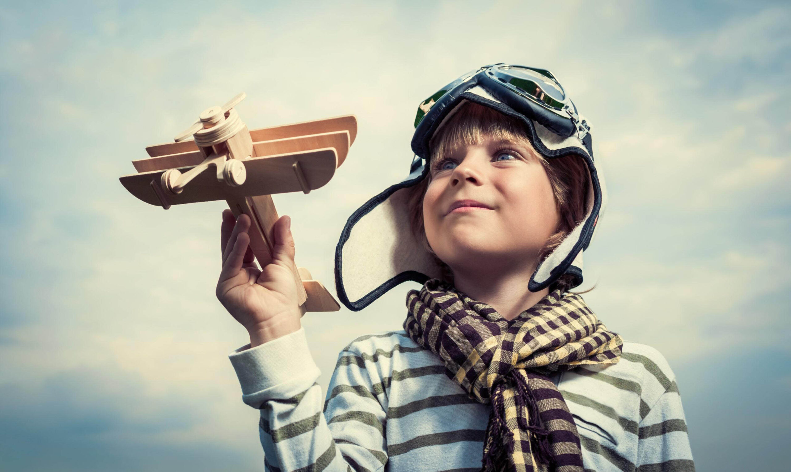 zbigstock-Pilot-with-airplane-on-a-backg-50984150 (Custom)